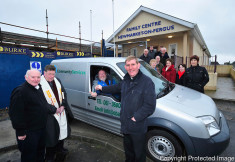 Fr Tom Fitzpartrick presents Hugh Tuohy, chairperson of Meals on Wheels, with the key to a new van at the Newmarket On Fergus Family Centre. Also pictured are Pat Cronin, manager of Obair Newmarket On Fergus, Canon Reuben Butler and members of the Obair organisation. Photograph by Declan Monaghan